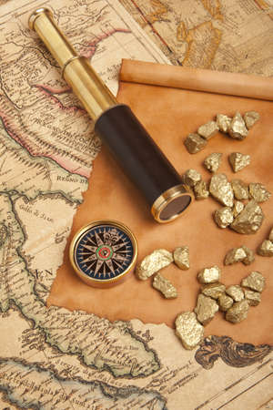 Gold nuggets and vintage brass telescope on antique map Stock Photo - 17567732