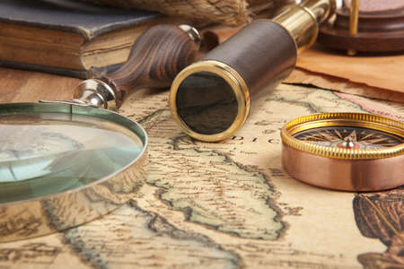 Vintage brass telescope on antique map Stock Photo - 17567739