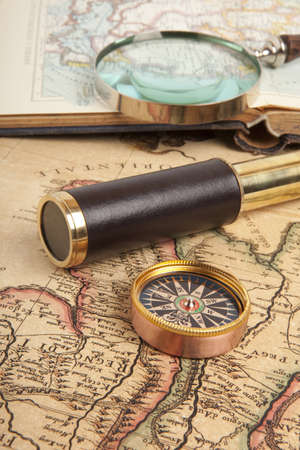 Vintage brass telescope on antique map Stock Photo - 17593982