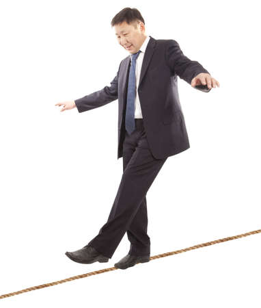 careerist: Asian businessman rope-walker. Isolated on white background