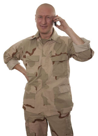 Soldiers calling on mobile phone on a white background photo