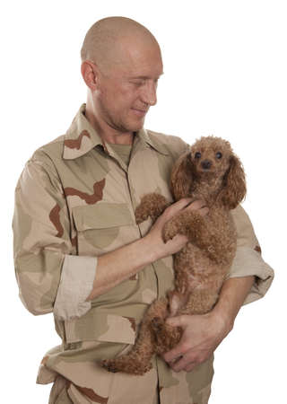 army man: Marine in camouflage uniform with a dog standing on a white background