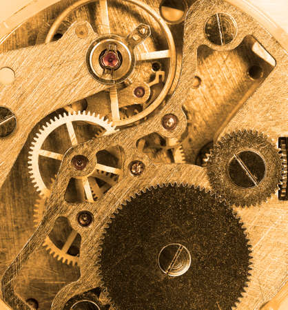 clock gears: Vintage old clock mechanism   Sepia color Stock Photo
