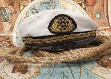 Captain's cap on vintage old map Stock Photo - 17726830
