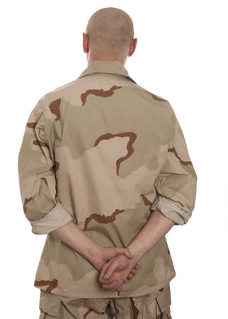 army men: Soldier in camouflage standing on a white background