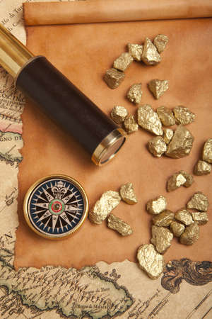 Gold nuggets and vintage brass telescope on antique map Stock Photo - 17752802