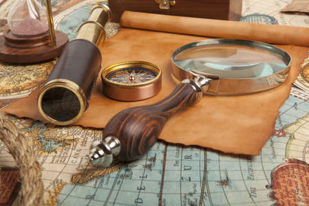 Vintage brass telescope on antique map photo