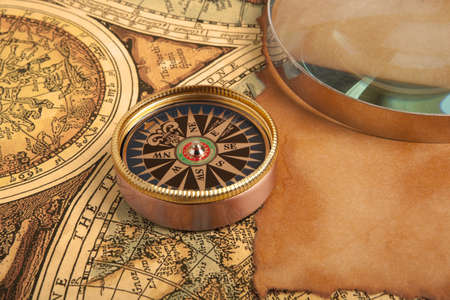 Old compass on old vintage map photo