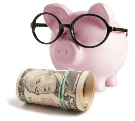 Piggy bank with glasses isolated  photo