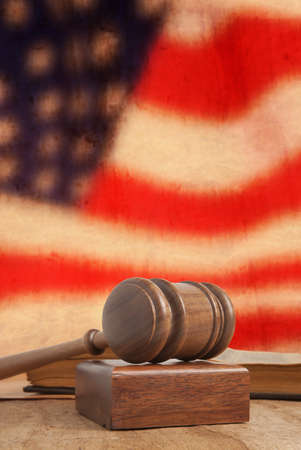 Wooden gavel and vintage USA flag photo