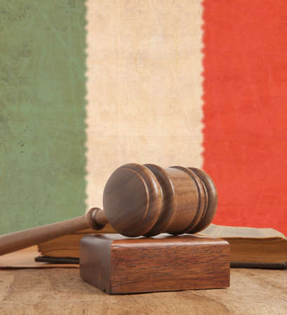 Wooden gavel and vintage flag Italy photo