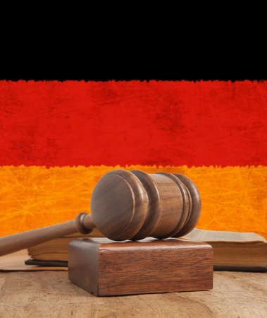 Gavel  and vintage flag of Germany photo