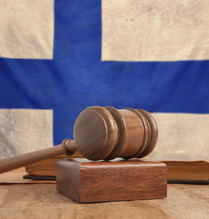 Wooden gavel and vintage Finland flag  photo