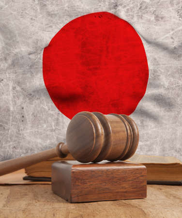 adjournment: Wooden gavel and vintage Japan flag