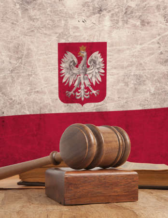 adjourned: Wooden gavel and vintage Poland flag