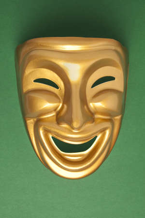 histrionics: Comedy  theatrical mask on a green background Stock Photo