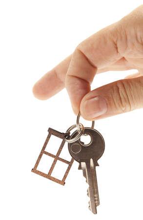 Zilveren sleutel geà ¯ soleerd op witte achtergrond