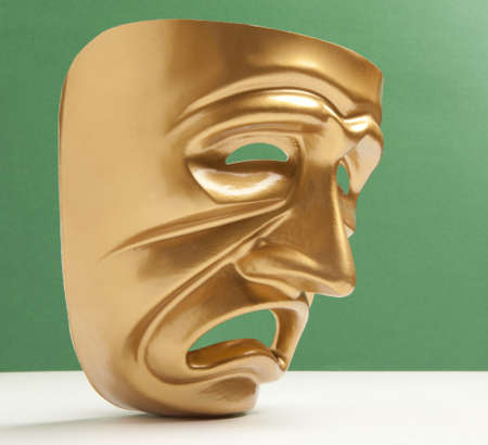 histrionics: Tragedy theatrical mask on a green background