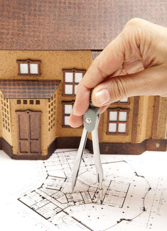 Female architect hand and house model photo