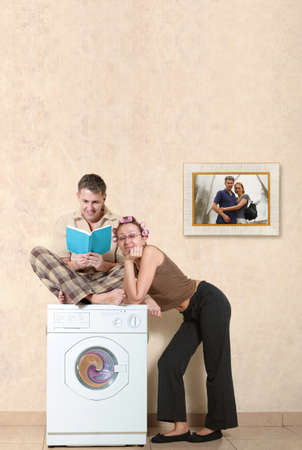 Ideal family washing clothes in a washing machine photo