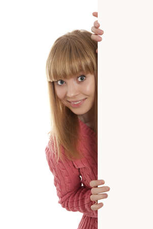 Happy smiling young woman showing blank signboard, isolated over white background Stock Photo - 18597087