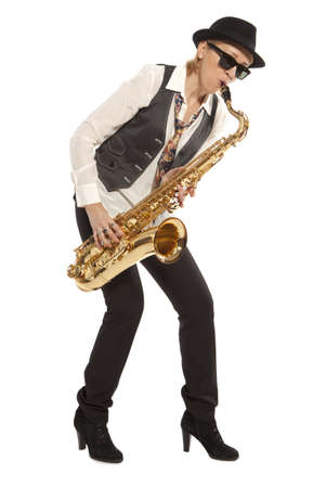 Saxophonist. Woman playing on saxophone isolated on background