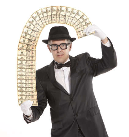 deceit: Magician. Happy businessman  with dollars. Isolated over white  Stock Photo