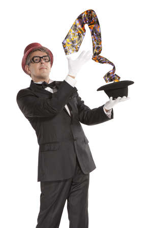 magus: A magician in a black suit holding an empty top hat isolated on white background  Stock Photo