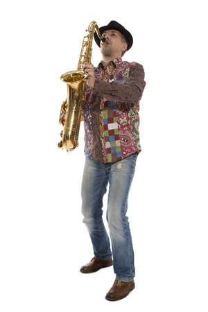 Saxophonist  Man playing on saxophone isolated on background Stock Photo - 19225135