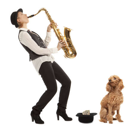 earns: Busker Musician woman with a dog earns money playing the saxophone