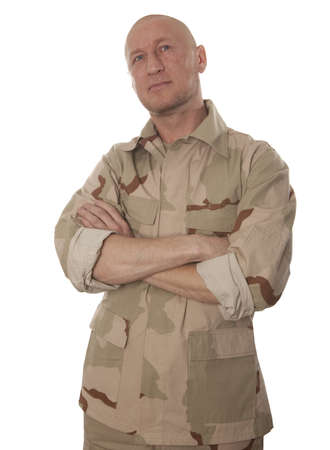 Commando in camouflage standing on a white background photo