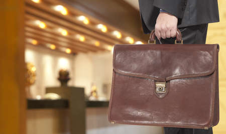 business briefcase: Businessman with briefcase in the hotel reception