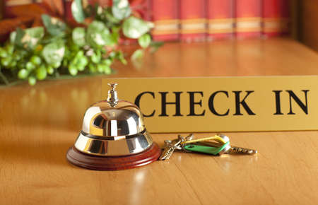 Vintage old hotel bell on the table photo