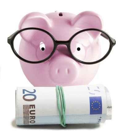 20 euro: Piggy bank isolated and twenty euro on white background