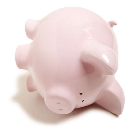 recession: Pink piggy bank upside down isolated on white background