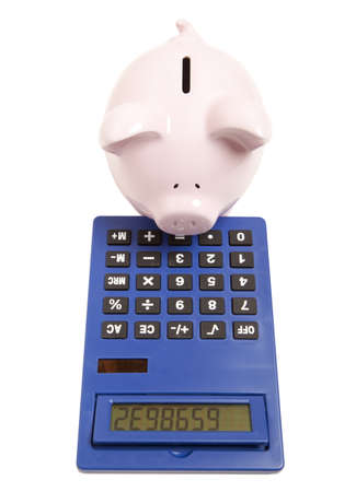 Piggy bank and calculator isolated on white background  photo