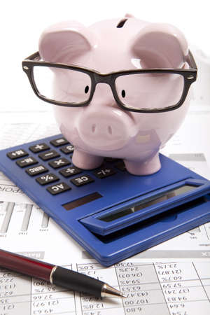 Pink piggy bank and calculator photo