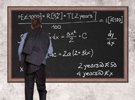 Business person standing against the blackboard  photo