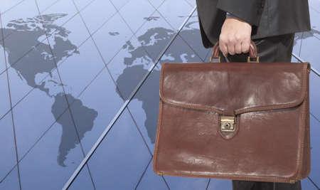 expansion: Businessman on world map background Stock Photo