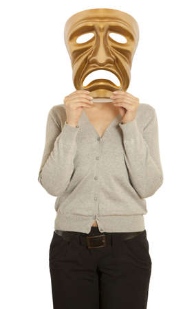 comedy tragedy: A woman holds a golden theatrical mask of tragedy