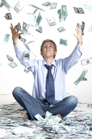 flying man: Happy businessman and flying dollar banknotes against white background  Stock Photo