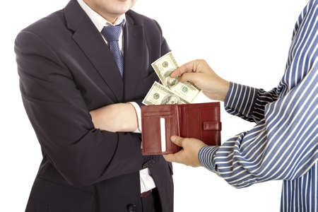 bribe: Giving a bribe. Dollar banknotes. White background