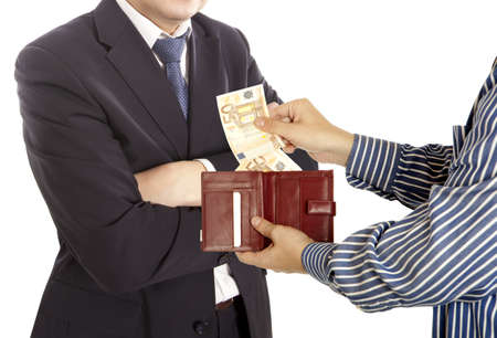 pervert: Giving a bribe. Euro banknotes. White background Stock Photo