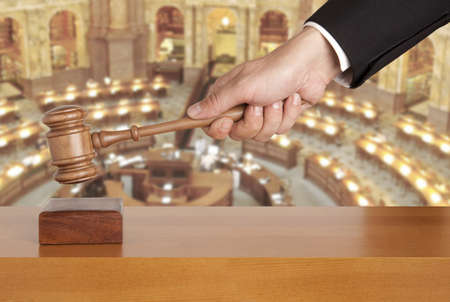 Gavel in hand against the background of the courtroom photo