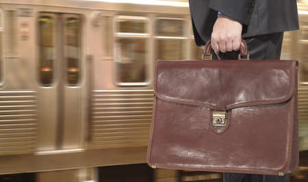 Businessman with a briefcase on a train station  photo