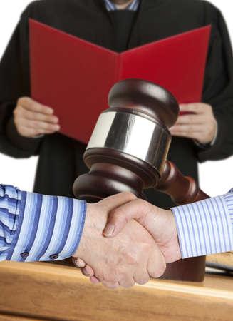 settlements: Settlement agreement against the background of judge Stock Photo