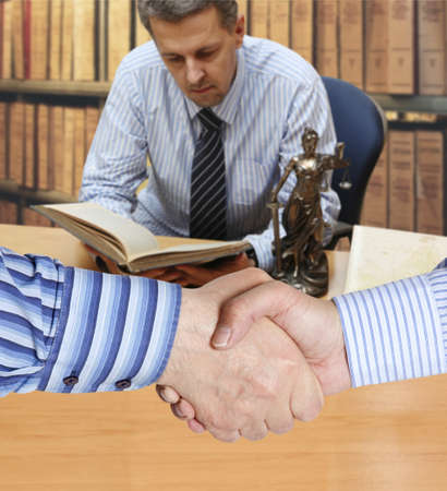 Settlement agreement against the background of lawyer or notary photo