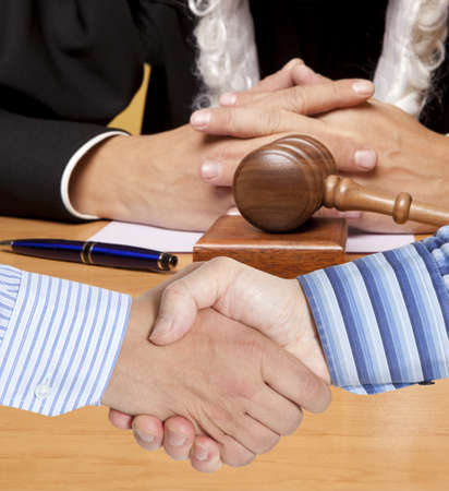 arbitration: Settlement agreement against the background of judge Stock Photo