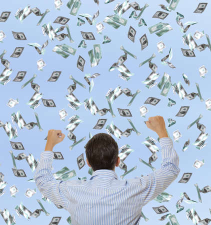 winning stock: Surprised businessman and flying dollar banknotes against blue sky