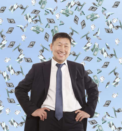 bank manager: Asian happy businessman and flying dollar banknotes against blue sky Stock Photo
